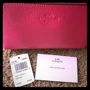 Coach hot pink cosmetic case